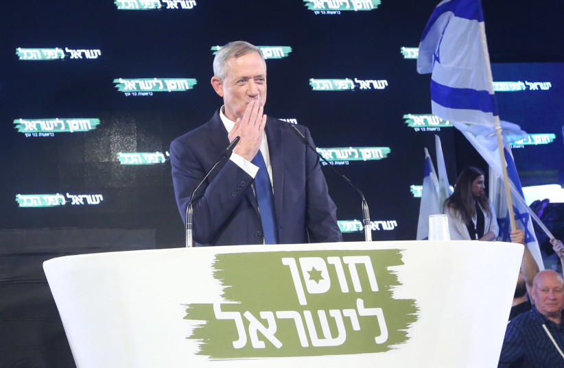 Benny Gantz, chairman of the Israel Resilience Party, blows a kiss to the crowd at an event launching his campaign, January 29th, 2019 (photo credit: MARC ISRAEL SELLEM/THE JERUSALEM POST)