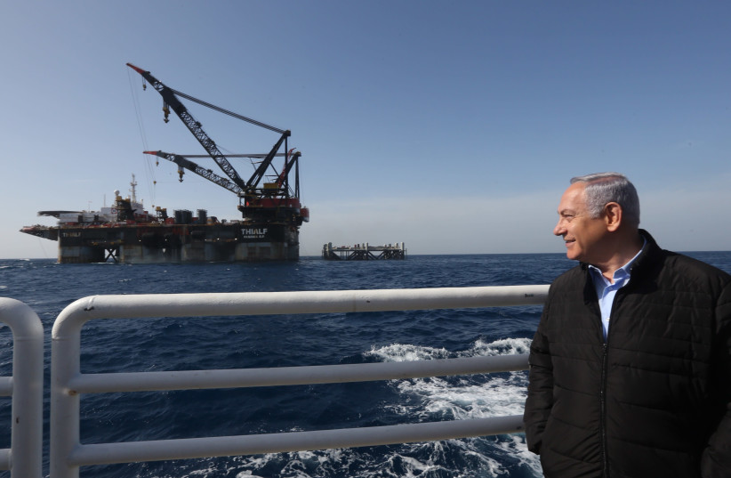 Prime Minister Benjamin Netanyahu looks on in front of the Leviathan gas platform (photo credit: MARC ISRAEL SELLEM)