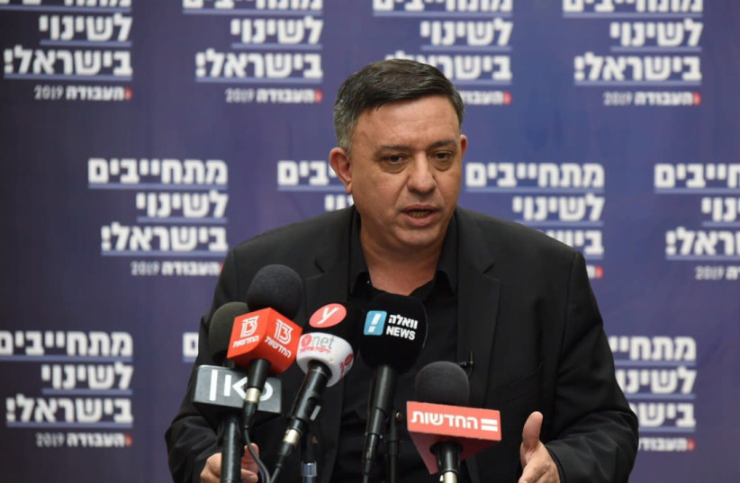 Labor leader Avi Gabbay speaks to mayors from his party Thursday in Haifa (photo credit: ELAD GUTMAN)