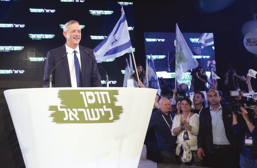 BENNY GANTZ listens to the cheers of the crowd gathered Tuesday night in Tel Aviv to hear his inaugural address.  (photo credit: MARC ISRAEL SELLEM)