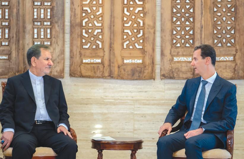 IRANIAN VICE President Eshaq Jahangiri meets with Syria's President Bashar Assad in Damascus this week.  (photo credit: SANA/REUTERS)