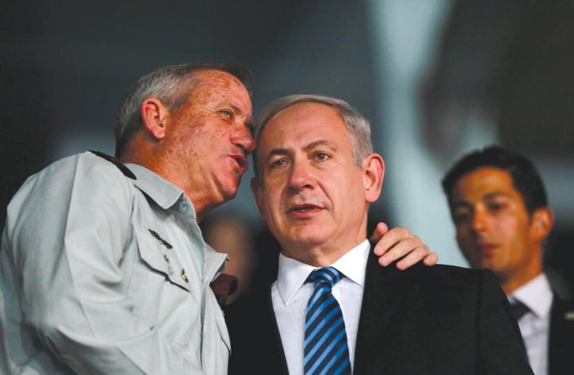 PRIME MINISTER Benjamin Netanyahu listens to then-IDF chief of staff Benny Gantz in 2013.  (photo credit: BAZ RATNER/REUTERS)