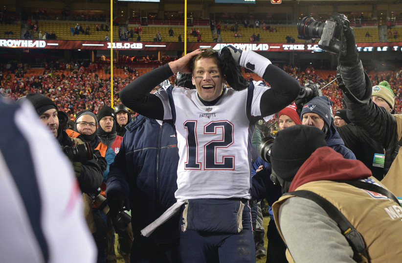 NEW ENGLAND PATRIOTS quarterback Tom Brady reacts after defeating the Kansas City Chiefs during overtime in the AFC Championship game at Arrowhead Stadium.  (photo credit: JAY BIGGERSTAFF-USA TODAY SPORTS)