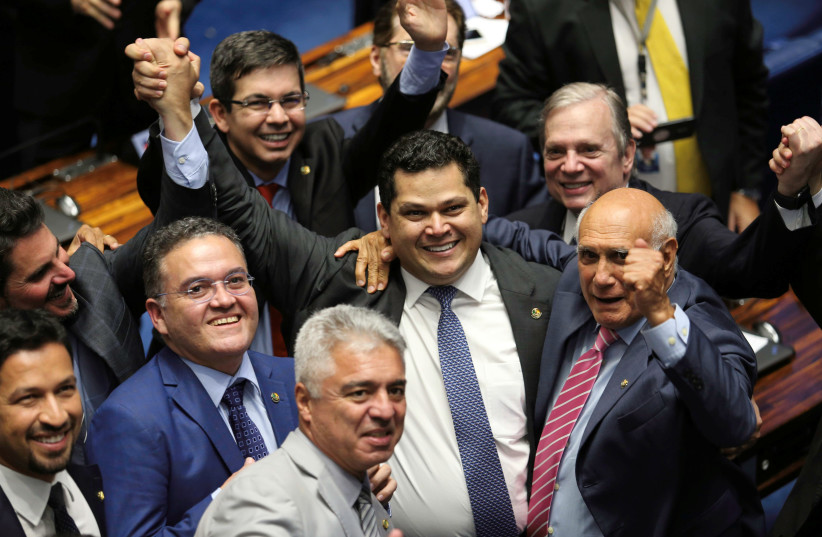 Davi Alcolumbre, from the Democratas party is congratulated by his colleagues after being elected for presidency of Brazilian senate in Brasilia, Brazil February 2, 2019. (photo credit: RODRIGUES POZZEBOM/AGENCIA BRASIL/HANDOUT VIA REUTERS ATTENTION EDITORS)