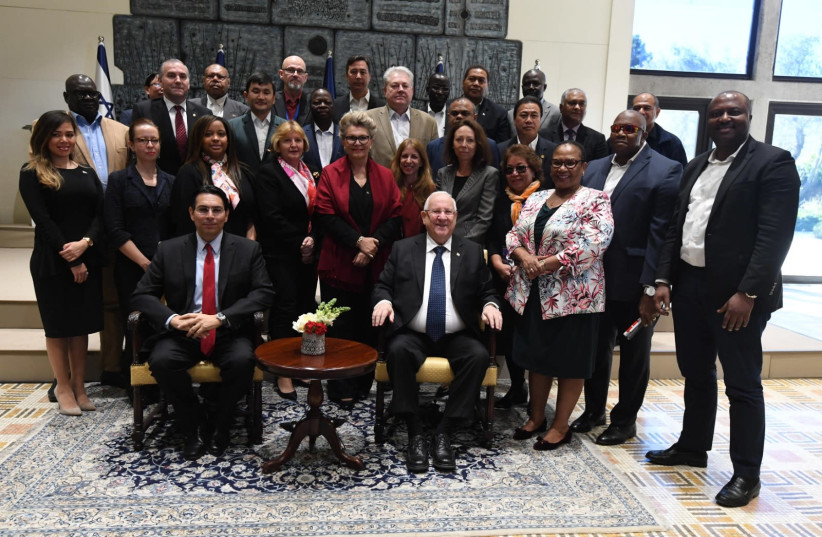 President Reuven Rivlin (front, right) and Ambassador to the U.N. Danny Danon (front, left) pose with visiting U.N. representatives, February 3rd, 2019 (photo credit: Mark Neiman/GPO)