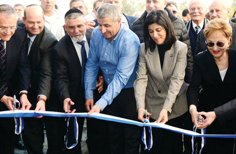 CUTTING THE ribbon at the Bar-Ilan University Research Institute in the Galilee Medical Center in Nahariya.  (photo credit: Courtesy)