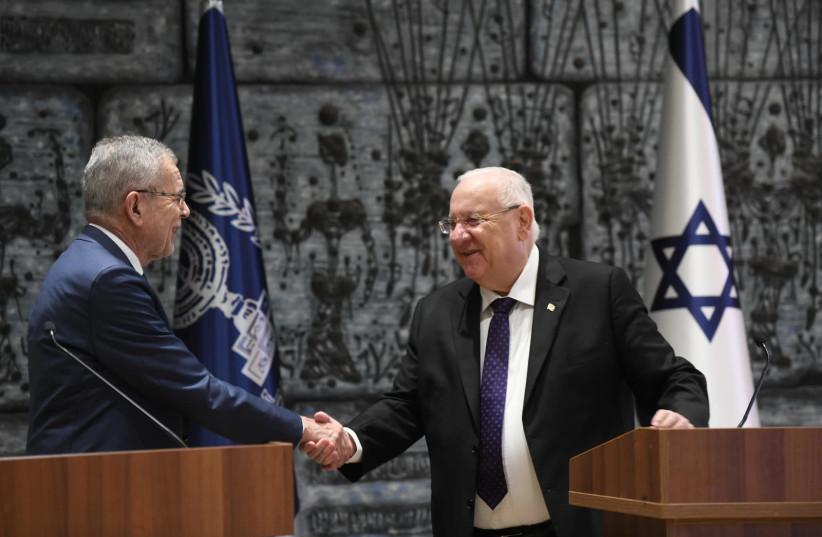 President Reuven Rivlin (R) shakes hands with Austrian President Alexander Van der Bellen (L), February 4th, 2019 (photo credit: AMOS BEN-GERSHOM/GPO)