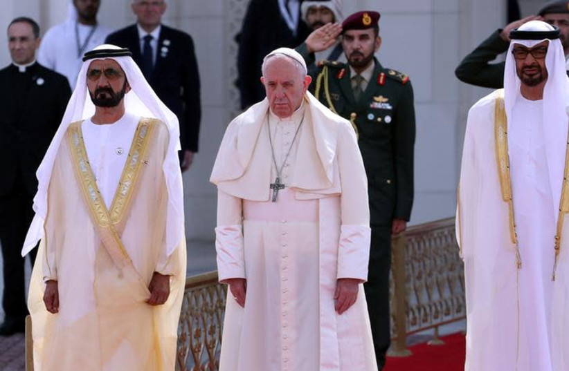 Pope Francis stands next to Vice-President of the United Arab Emirates and ruler of Dubai Sheikh Mohammed bin Rashid al-Maktoum, and Abu Dhabi's Crown Prince Mohammed bin Zayed Al-Nahyan during a welcome ceremony at the Presidential Palace in Abu Dhabi, United Arab Emirates, February 4, 2019 (photo credit: REUTERS/TONY GENTILE)