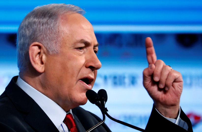 Prime Minister Benjamin Netanyahu gestures as he speaks at the Cybertech 2019 conference in Tel Aviv (photo credit: AMIR COHEN/REUTERS)