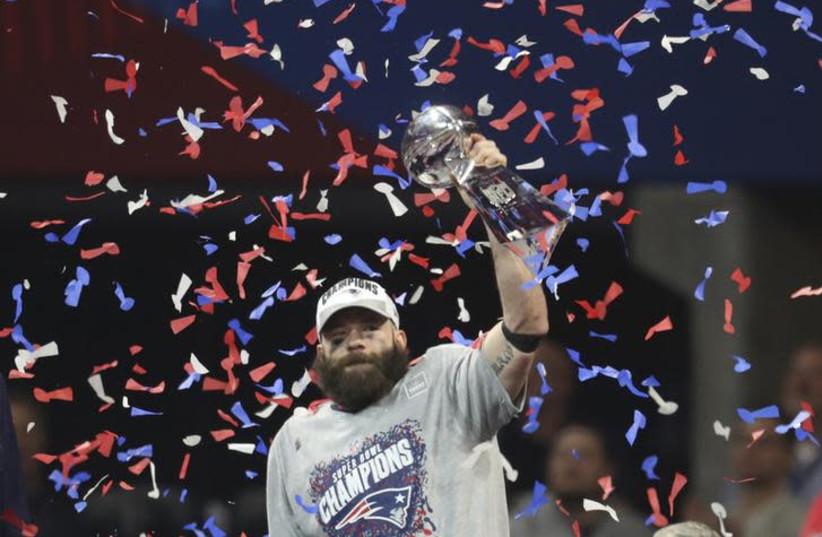 Super Bowl MVP Julian Edelman (11) celebrates with the Vince Lombardi Trophy after Super Bowl LIII at Mercedes-Benz Stadium (photo credit: REUTERS)