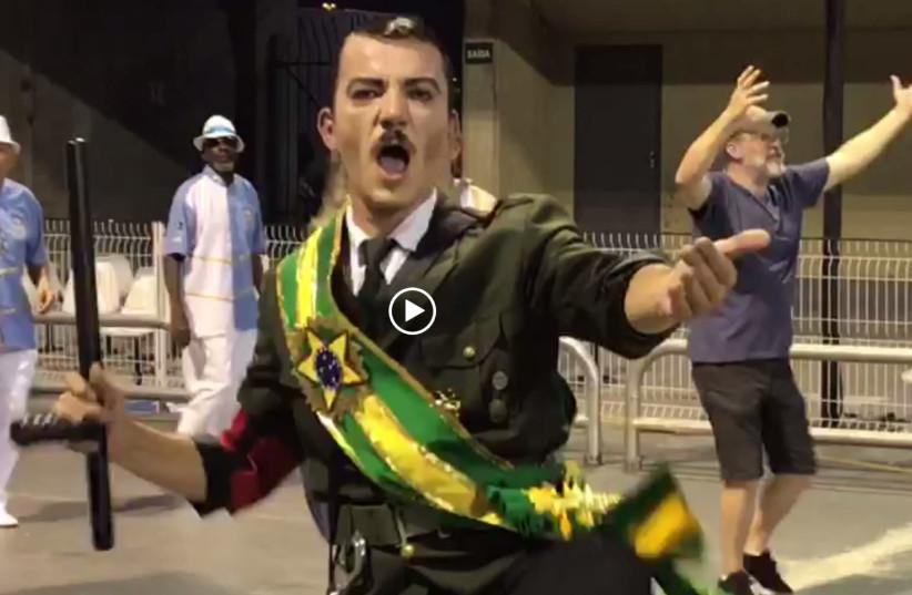 A Samba dancer in Brazil in a mock-outfit claiming  Brazilian President Jair Bolsonaro is like Adolf Hitler  (photo credit: screenshot)