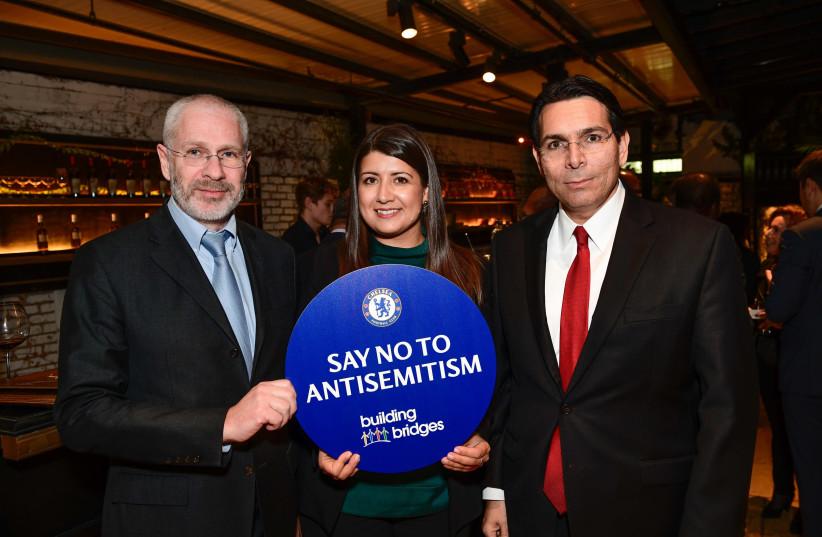 Israeli ambassador to the UN Danny Danon, Chelsea FC Director Eugene Tenenbaum and Rola Brentlin, Chelsea FC's Say No to Antisemitism Campaign, 2019. (photo credit: SHAHAR AZRAN / WJC)