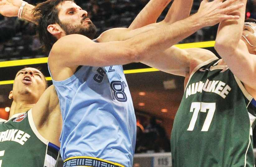 MEMPHIS GRIZZLIES' forward Omri Casspi will undergo surgery this week for a torn meniscus in his right knee. To road back to the NBA is sure to be challenging for the 30-year-old Israeli.  (photo credit: REUTERS)