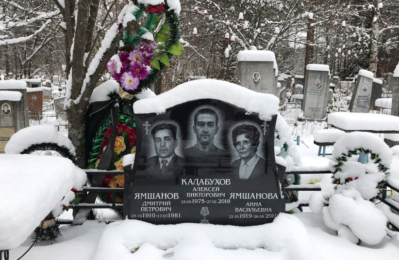 The name of Russian private military contractor Alexei Kalabukhov (C), killed in Syria, is seen at a gravestone at a cemetery in Kirov, Russia November 27, 2018. (photo credit: MARIA TSVETKOVA/REUTERS)