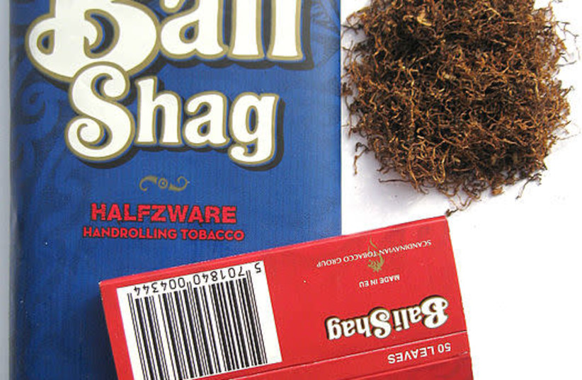 A 40g pouch of Bali Shag Halfzware, Bali Shag Halfzware tobacco and red Bali Shag rolling papers (photo credit: HANGFIB/WIKIMEDIA COMMONS)