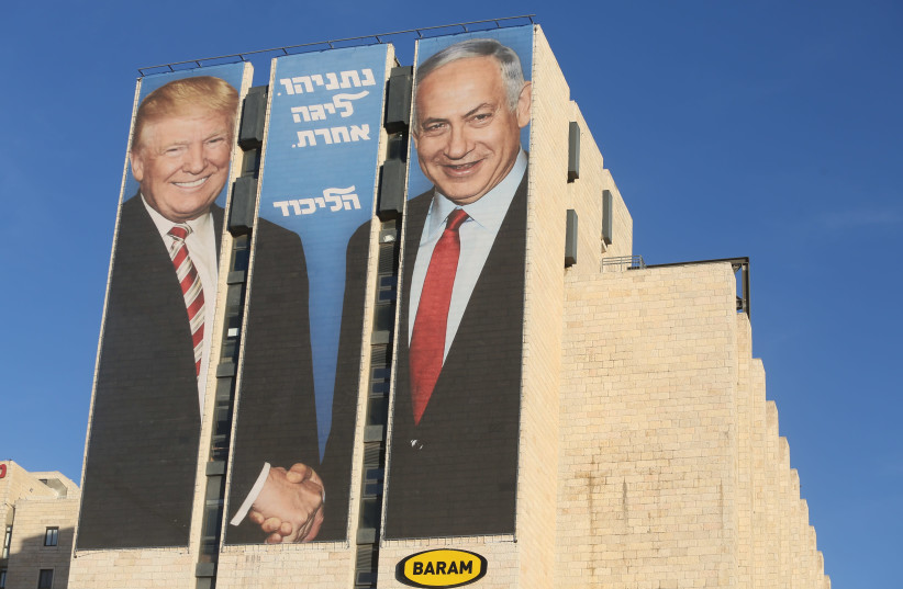 Elections poster showing Prime Minister Benjamin Netanyahu shaking hands with US President Donald Trump (photo credit: MARC ISRAEL SELLEM)