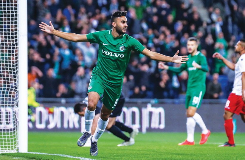 MACCABI HAIFA captain Muhamad Awad celebrates after scoring the first of his two goal in the Greens' dramatic 3-2 victory over Hapoel Tel Aviv in Israel Premier League action on Monday night. (photo credit: MAOR ELKASLASI)