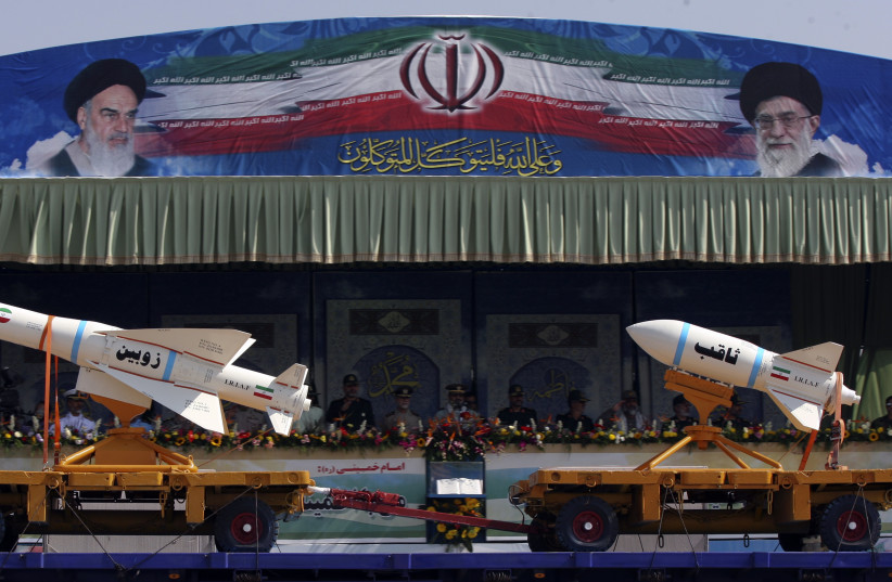 A military vehicle carrying Iranian Zoobin smart bomb (L) and Sagheb missile under pictures of Iran's Supreme Leader Ayatollah Ali Khamenei (R) and Late Leader Ayatollah Ruhollah Khomeini during a parade to commemorate the anniversary of the Iran-Iraq war (1980-88), in Tehran September 22, 2011. (photo credit: REUTERS/STRINGER)