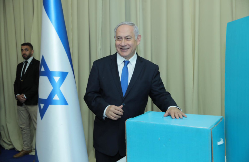 Prime Minister Benjamin Netanyahu after voting in the Likud primaries (photo credit: LIKUD)