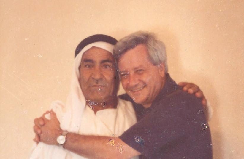 ARNOLD BASKIN and his friend Abu Ali Abu Zghair in Kafr Kara in 1979 (photo credit: Courtesy)