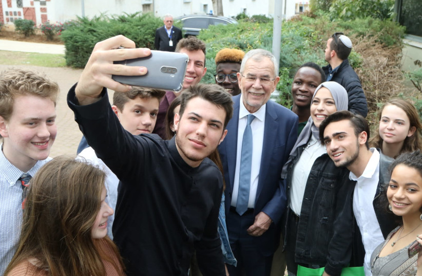 Australian President Alexander Van der Bellen poses for a selfie with students from the Givat Haviva Internationa School. (photo credit: Courtesy)