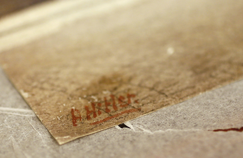 The signature of former German dictator Adolf Hitler is seen on a painting of the old registry office in Munich, at Weidler auction house in Nuremberg. (photo credit: KAI PFAFFENBACH/REUTERS)