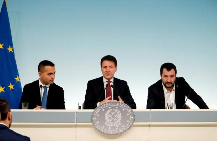 Italy's Minister of Labor and Industry Luigi Di Maio, Prime Minister Giuseppe Conte and Interior Minister Matteo Salvini (photo credit: REUTERS/REMO CASILLI)