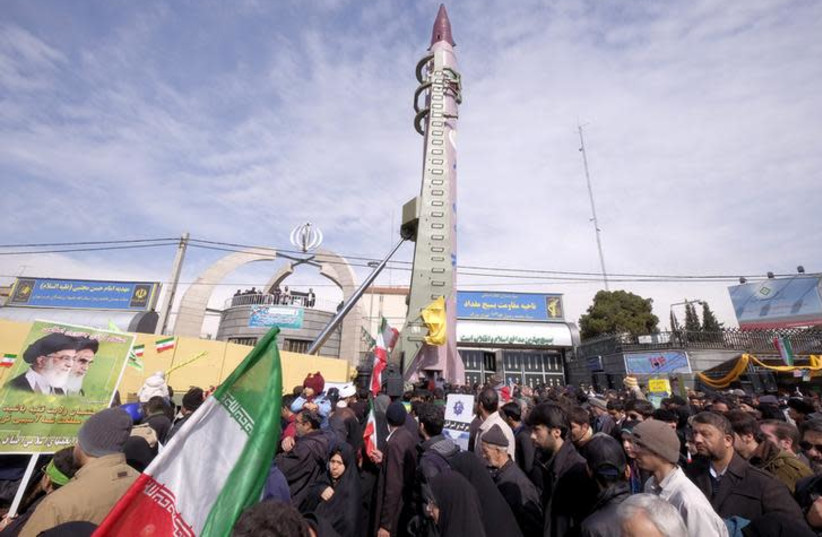 Iranian-made Emad missile is displayed during a ceremony (photo credit: REUTERS/RAHEB HOMAVANDI)
