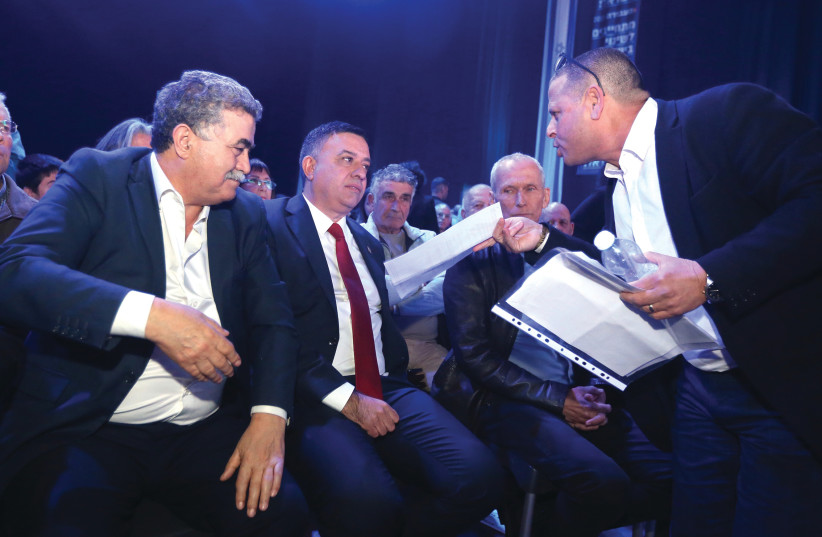 LABOR LEADER Avi Gabbay is harangued by MK Eitan Cabel (right) as MK Amir Peretz looks on during a meeting of the party last month (photo credit: MARC ISRAEL SELLEM/THE JERUSALEM POST)