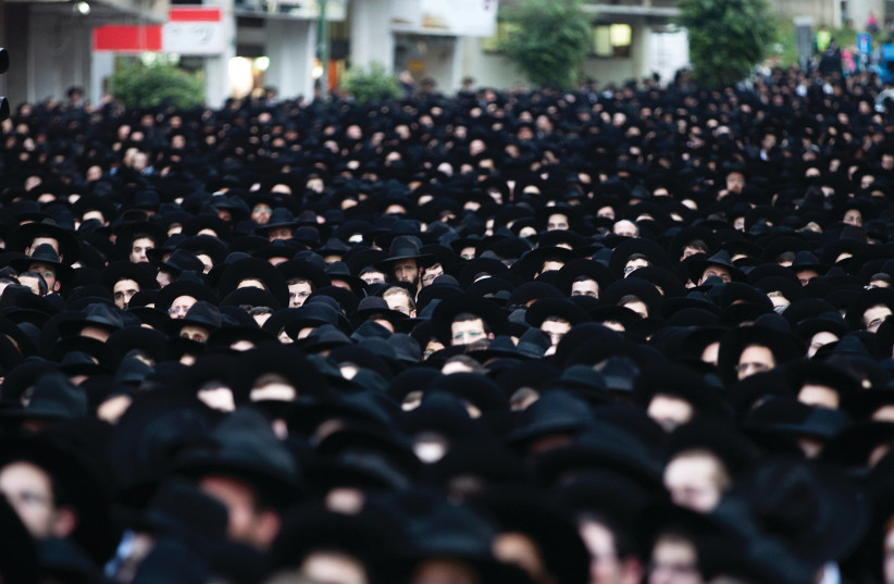 HAREDIM GATHER en masse in Bnei Brak. Is their leadership's political model sustainable? (photo credit: RONEN ZVULUN / REUTERS)