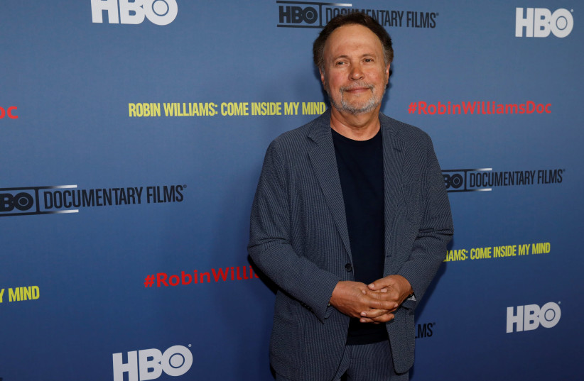 """Actor Billy Crystal poses at the premiere for the documentary """"Robin Williams: Come Inside My Mind"""" in California, 2018. (photo credit: REUTERS/MARIO ANZUONI)"""