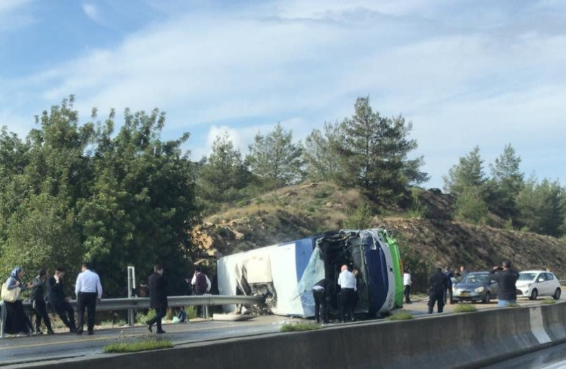 The overturned bus, February 10th, 2019 (photo credit: Courtesy)