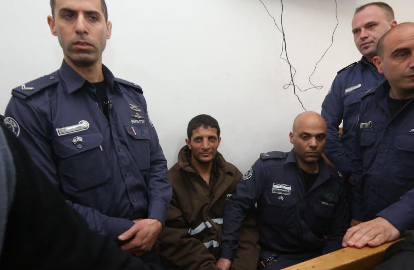 Arafat Irfaiya, Ori Ansbacher's murderer, brought to court (photo credit: MARC ISRAEL SELLEM/THE JERUSALEM POST)