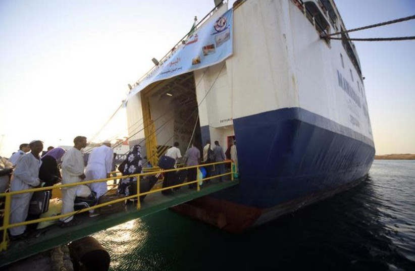 Pilgrims board a ferry at Suakin port in the Red Sea state (photo credit: REUTERS/MOHAMED NURELDIN ABDALLAH)
