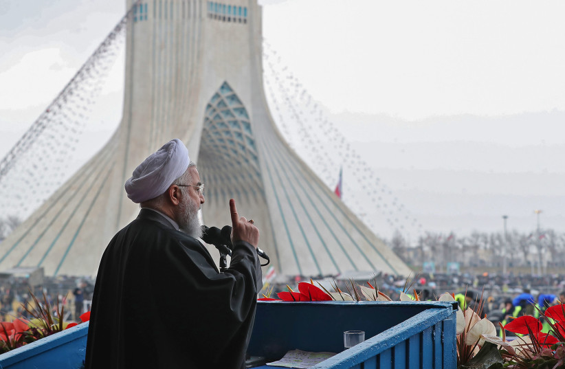 A handout picture provided by the Iranian presidency on February 11, 2019 shows President Hassan Rouhani addressing crowds during a ceremony celebrating the 40th anniversary of Islamic Revolution in the capital Tehran's Azadi (Freedom) square (photo credit: HO / IRANIAN PRESIDENCY / AFP)
