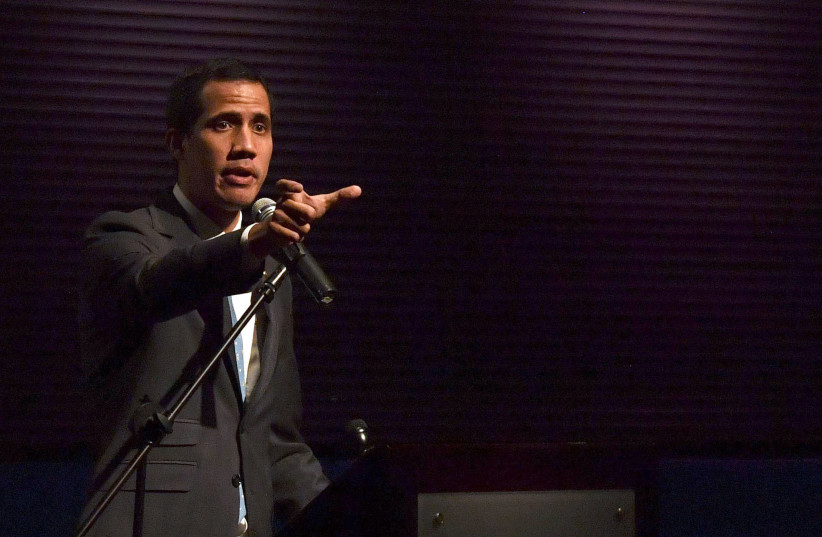 Venezuela's National Assembly head and self-proclaimed acting president Juan Guaido gestures while speaking to students at the Metropolitan University in Caracas, on February 11, 2019 (photo credit: YURI CORTEZ/AFP)