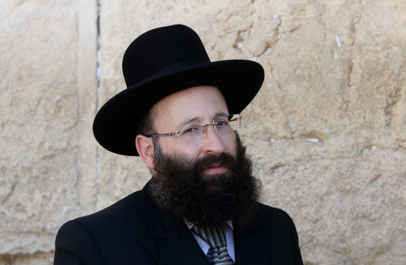 Rabbi Shmuel Rabinowitz, Rabbi of the Western Wall, poses for a photo in front of the holy site (photo credit: MARC ISRAEL SELLEM/THE JERUSALEM POST)