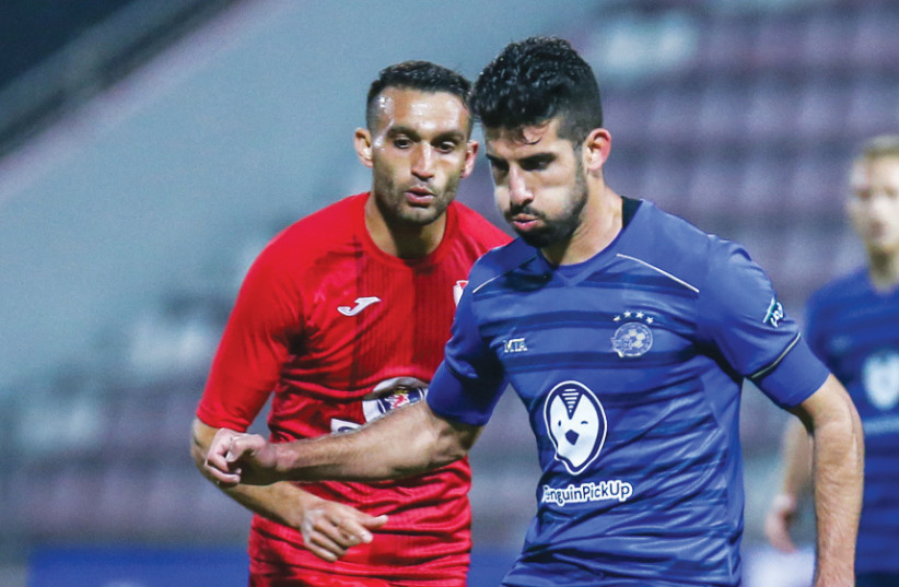 YONATAN COHEN and first-place Maccabi Tel Aviv were unable to solve the Bnei Sakhnin defense in a 0-0 draw on Monday night in Israel Premier League action (photo credit: MAOR ELKASLASI)