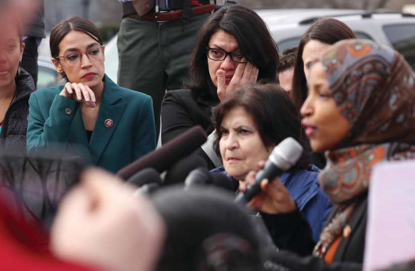 US REPRESENTATIVE Alexandria Ocasio-Cortez and Representative Rashida Tlaib wipe away tears as Representative Ilhan Omar talks about her experience as a refugee earlier this month (photo credit: REUTERS)