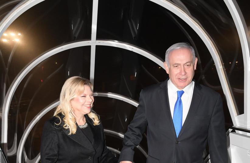 Prime Minister Benjamin Netanyahu and his wife Sara boarding the plane to Warsaw (photo credit: AMOS BEN-GERSHOM/GPO)