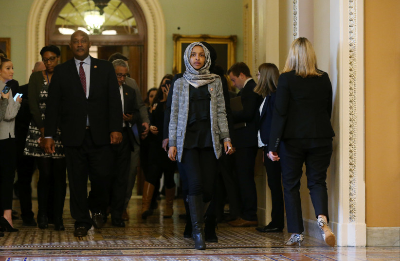 U.S. Rep. Ilhan Omar leaves Senate after watching failure of competing proposals to end government shutdown. (photo credit: LEAH MILLIS/REUTERS)