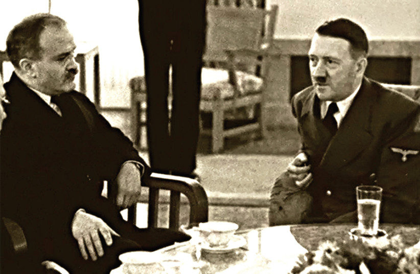 ADOLF HITLER dines with Russian foreign minister Vyacheslav Molotov in 1940. (photo credit: FLICKR)