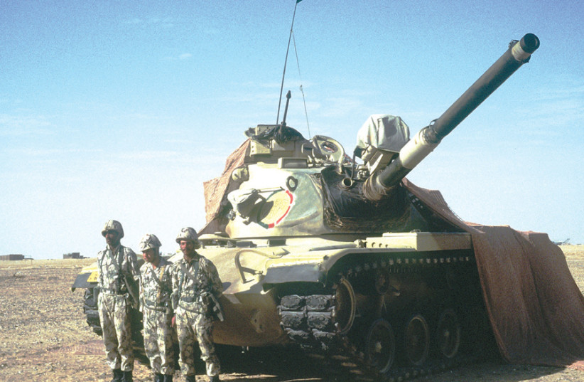 EGYPTIAN SOLDIERS stand in front of a 3rd Armored Brigade M-60 battle tank during the Gulf War in 1990. (photo credit: US AIR FORCE)