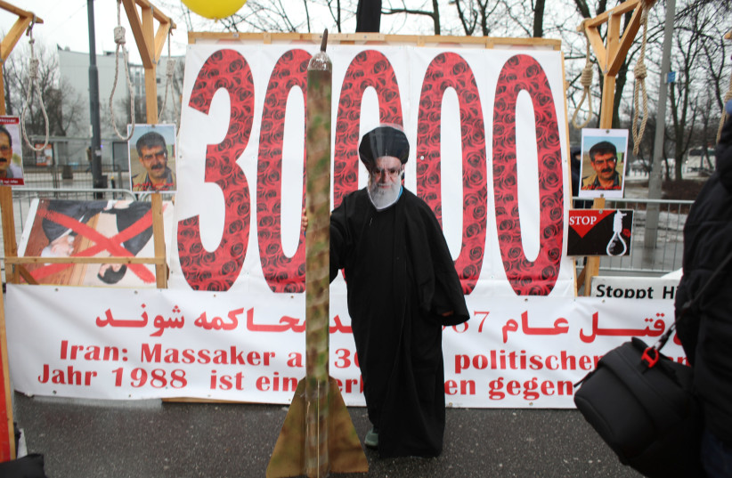 Iranian communities in Europe hold a rally to protest against Iranian government's human rights violations during a global summit focused on the Middle East and Iran in Warsaw, Poland February 13, 2019 (photo credit: AGENJCA GAZETA/ REUTERS)