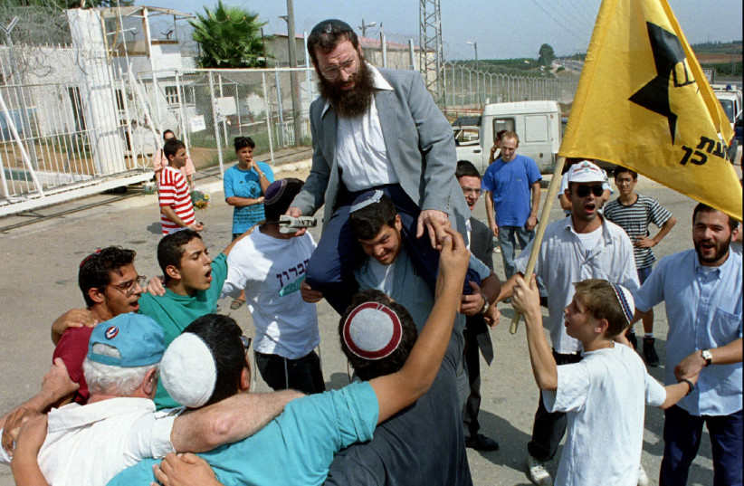 Baruch Marzel with supporters. File photo (photo credit: HAVAKUK LEVISON / REUTERS)