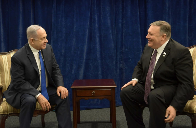 Prime Minister Benjamin Netanyahu meets with US Secretary of State Mike Pompeo at the Waraw Conference on February 14, 2019 (photo credit: AMOS BEN GERSHOM, GPO)