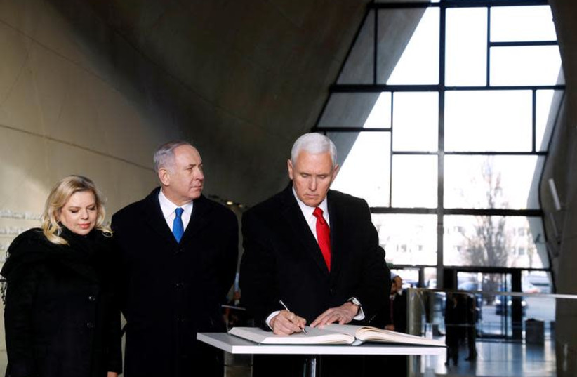U.S. Vice President Mike Pence, Prime Minister Benjamin Netanyahu and his wife Sara visit the Jewish Museum in Warsaw, Poland, February 14, 2019 (photo credit: KACPER PEMPEL / REUTERS)