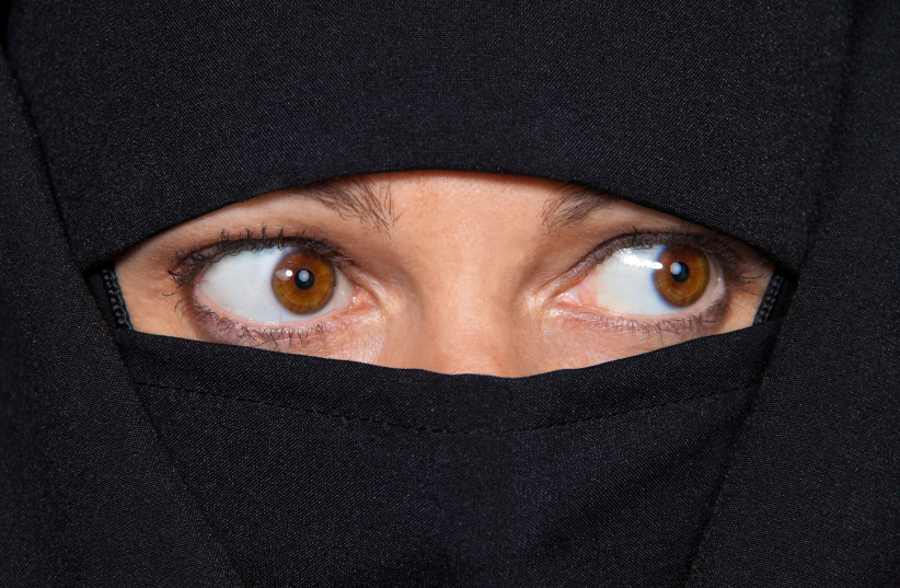 Muslim in a burka.  (photo credit: INGIMAGE)