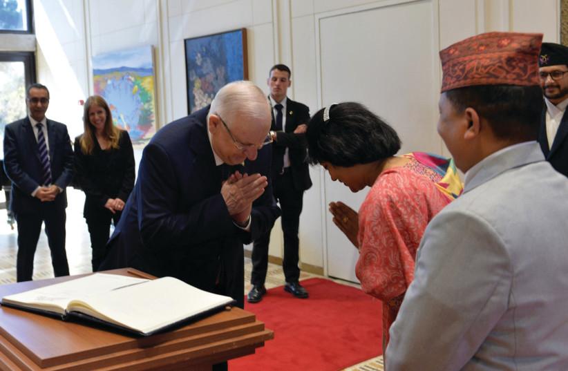 President Reuven Rivlin welcomes Ambassador Dr. Anjan Shakya of Nepal (photo credit: KOBI GIDEON/GPO)