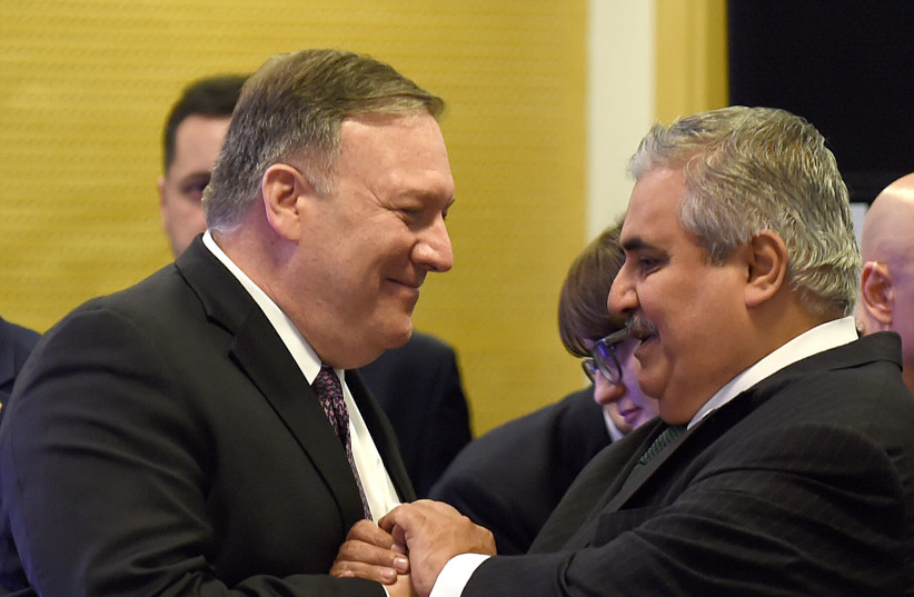 US Secretary of State Mike Pompeo (L) greets Bahrain Foreign Minister Khalid bin Ahmed al-Khalifah before a working lunch at the conference on Peace and Security in the Middle East in Warsaw, on February 14, 2019 (photo credit: JANEK SKARZYNSKI / AFP)
